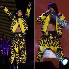 Rihanna performing during The Monster Tour in Asger Juel Larsen Fall 2013 flame jacket and pants, Dr. Martens Jadon white platform boots, Ambush crest choker, Lynn Ban rings