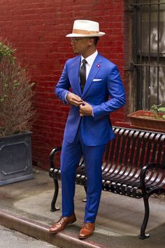Shop this look for $323:  http://lookastic.com/men/looks/dress-shirt-and-tie-and-blazer-and-pocket-square-and-dress-pants-and-derby-shoes/1173  — White Dress Shirt  — Black Silk Tie  — Blue Blazer  — White Pocket Square  — Blue Dress Pants  — Walnut Leather Derby Shoes