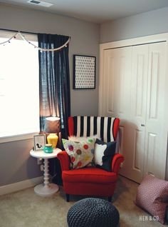 This orange chair from @IKEA USA is the perfect pop of color in this modern nursery! #nursery