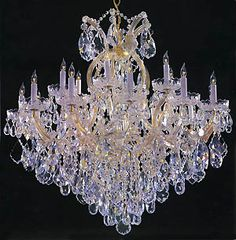 Extremely intricate in design, this beautiful crystal chandelier easily becomes the focal point of any entryway or dining room. Featuring 18 lights on the outside and one in the center, this breathtak