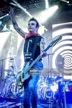 Simon Gallup of The Cure performs at Bayfront Park Amphitheater on June 26, 2016 in Miami, Florida.