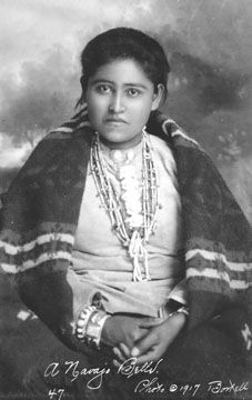 Navajo Belle, 1917 .....note the layers of necklaces, heishe, jaclas, chunky silver bracelets, and Pendleton blanket.