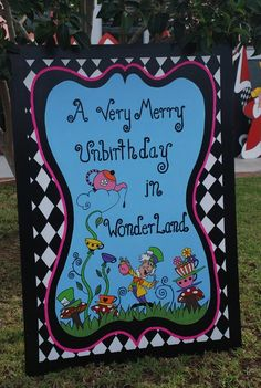 Great Alice in Wonderland birthday welcome sign! See more party ideas at CatchMyParty.com. #aliceinwonderland #girlbirthday #partydecorations