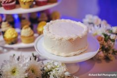 Closeup of the adorable mini-wedding cake at the McClanahan & Elliott wedding | Photo credit Richard Bell Photography #weddingcupcakes