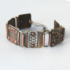 Bracelet | Cyndie Smith. Sterling silver, brass and copper.