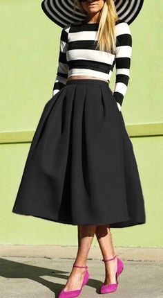 Obsessed with this black flare pleated midi skirt