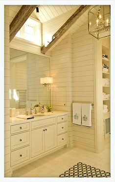 I LOVE THE OPEN CLOSET STORAGE AND THE WINDOW ABOVE REACHING TOWARD THE VAULTED CEILING.