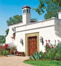 One possibility. . .     This Andalusian-style residence has a grand entrance incorporating a salvaged 18th-century Spanish gate. Iberian-inspired touches (arched windows, cut-metal light fixtures, wrought-iron railings) animate the rooms, all but a few of which are organized around a skylit atrium.