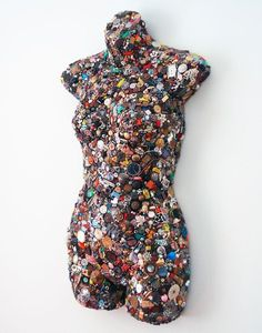 'Betty' ~ a mannequin that is covered in thousands of found objects, such as watch parts, vintage crackerjack prizes, vintage and antique jewelry, campaign buttons, coins, screws, bolts, bones, old bottle caps, and miniature doll parts.