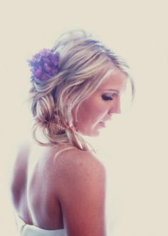 Gorgeous updo accented with a dreamy floral hairpiece. Photo by Joseph Mark Photography.
