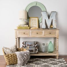 Entryway Inspiration: With its coastal colors and striking contrast of wood and metal décor, this entryway's as relaxing and calm as a day at the beach.