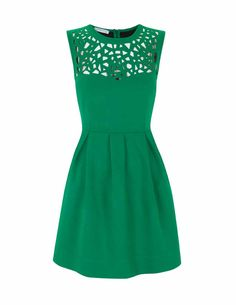 love the emerald green and the design of the top, saint patricks day anyone?