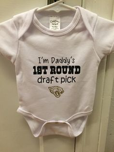 A personal favorite from my Etsy shop https://www.etsy.com/listing/225962577/jacksonville-jaguars-onesie-daddys-1st
