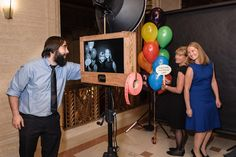 Fotio brought in a vintage-style camera decked with a roll of carnival tickets. Guests posed with colorful balloons and signs that referenced songs from Carousel.  Photo: Bob Kusel