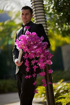 Phalaenopsis and mokara orchid cascade. Nisie's Enchanted Florist Los Alamitos, CA; Tuxedo: Tuxedos by Mike Hollywood, CA; Photography: Mike Colón Photographers Newport Coast, CA