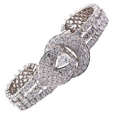 M. GERARD white gold bracelet with diamonds and center pear shape of ~0.80 carat D color VS1 clarity. Contains 223 stones with 23.08 carats total weight.. France 1940s