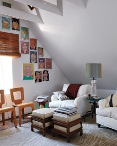 Neutral furniture paired with colorful portraits
