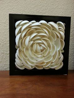 Check out this item in my Etsy shop https://www.etsy.com/listing/246274507/seashell-flower-wall-art