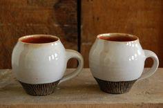 black and white carved egg-shaped mugs. $26.00, via Etsy.