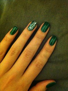Emerald nails with glitter accent nail.