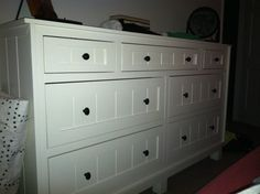 Here is a custom dresser built by Woods Cabinets, with bead board drawers and a white finish.