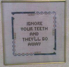 cross stitch on my dentist's wall