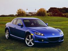 2004 Mazda RX-8. 6spd, 1.8 Rotorary-Wankle Renesis motor.  Not much HP but truly a fun high-revving car.