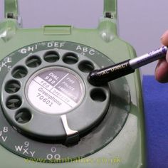 Using a pencil eraser to dial phone. Saved your fingers if you had a lot of calls to make.