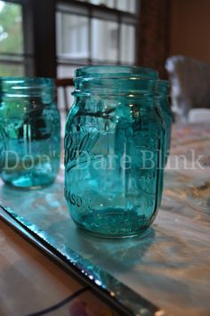 An easy step-by-step tutorial showing how to make colored jars by tinting mason jars with Mod Podge.