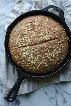 This Whole Wheat No-Knead Skillet Bread is so incredibly easy, crusty and delicious! It makes a perfect bread to serve with meals with soft butter or a dish of olive oil. | @tasteLUVnourish on TasteLoveAndNourish.com