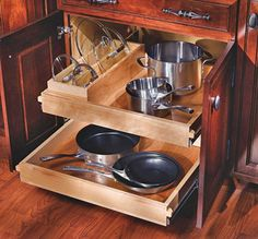 Kitchen storage I like the extra slot  for lids.