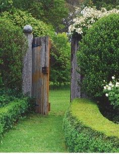 Entrance to a wonderful secret garden. I love this tall wooden gate between the even taller hedges. to a wonderful secret garden. I love this tall wooden gate between the even taller hedges. Tor Design, Gate Design, Rustic Gardens, Outdoor Gardens, The Secret Garden, Secret Gardens, Garden Doors, Garden Gate, Garden Entrance