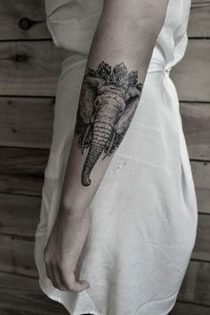 Stylish Elephant Tattoo  I thought the trunk was a growth coming off of the persons body for a moment!! XD