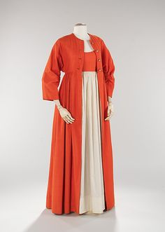 Designer Claire McCardell, always inventive, showed her diverse use of simple fabrics by making this 1950 evening dress out of typical daywear fabric, cotton and linen. The silhouette of the dress is reminiscent of the Empire period, as seen in the waist line of the dress and jacket. The kimono treatment of the sleeves is a signature of McCardell and heightens the design aesthetic of the piece. Quite casual overall, the single formal accent is that of the pearl buttons on the coat.