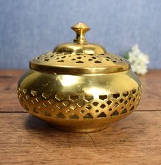 Vintage round fretwork brass box with lid by GilbertandCrick on Etsy https://www.etsy.com/listing/474250718/vintage-round-fretwork-brass-box-with