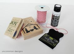 Rubber stamps and white paint on dark fabric for a chalk-like effect.
