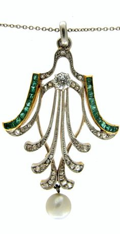 Emerald & Diamond Art Deco Pendant on Chain  Art Deco (1920-1935).  This pendant has wonderful lines. It is just so stylish that I could not resist buying it. it is set with calibre cut emeralds and old cut and rose diamonds with a large natural pearl drop. I love the contrast of platinum and 18ct gold which was common practice in the 1920s. The chain is original to the pendant and is also platinum.