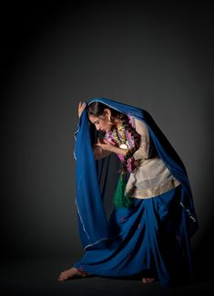 A traditional Bhangra dancer in movement in the studio http://simonlewisstudio.photoshelter.com/