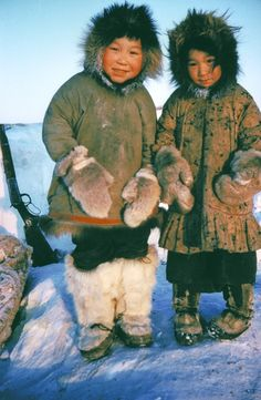 THE CHILD ON THE LEFT WOULD BE INUK SO CUTE..well with white hair (Inuit - indigenous peoples inhabiting the Arctic regions of Greenland, Canada, the United States, and Russia.)