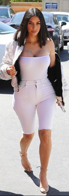 Kim Kardashian : Shirt – Naked Wardrobe Shorts – Good American Shoes – Manolo Blahnik