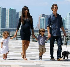 Sunday fun day: Matthew McConaughey strolled the streets of New York today with wife Camila Alves along with their children and pet pooch