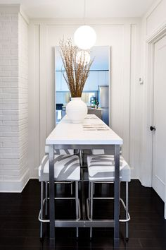 50 ways to make the MOST of your tiny apartment. #15: Is your dining space little more than an alcove? Double it (visually) with a smartly placed mirror; then, add a super-slim profile table with tools that tuck neatly underneath