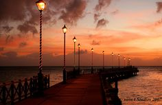 Walk to the end of the Speightstown boardwalk at sunset for the perfect end to your perfect day in #Barbados