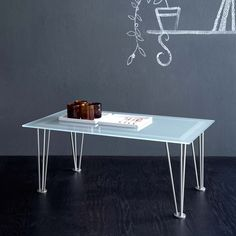 Vega Coffee Table This table has a minimalist, simple and elegant design. Its materials make it resistant and light and it can be easily moved around the house. It is a nice desk or an ornament for your dining room.  Materials are durable, reliable.