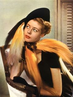 Orange feather hat Rose Valois, L'Officiel December 1947