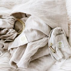 Lillebaby ring sling! The best way to survive those early days with a snuggly baby and needy 1 year old.