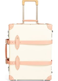 This refined yet vintage suitcase is designed with a telescoping pull handle and smooth gliding wheels for easy transport through busy airport terminals.
