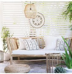 a welcoming tropical patio with a rustic wooden bench with pillows, a wicker lamp, a woven ottoman and a rattan candle holder Outdoor Rooms, Outdoor Living, Outdoor Decor, Outdoor Areas, Rustic Wooden Bench, Tropical Patio, Tropical Vibes, Deco Zen, Interior And Exterior