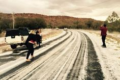 """Hail on the road in Alice Springs. Yes, Alice Springs, after a hail storm described by a forecaster as """"unusual"""". (Photo: Supplied/David Batty)"""