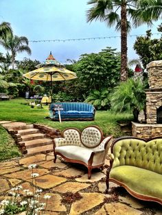 Funky vintage couches for a backyard wedding from Teal green design rentals!